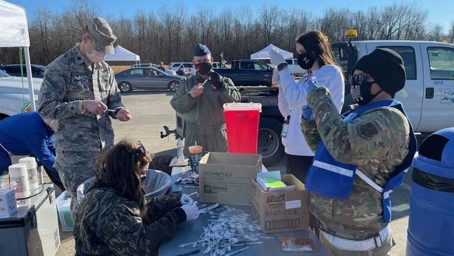 Members of the Missouri National Guard hosting Missouri's first mass COVID-19 vaccination site in Poplar Bluff on Jan. 22 (photo courtesy of Missouri Governor's Office).