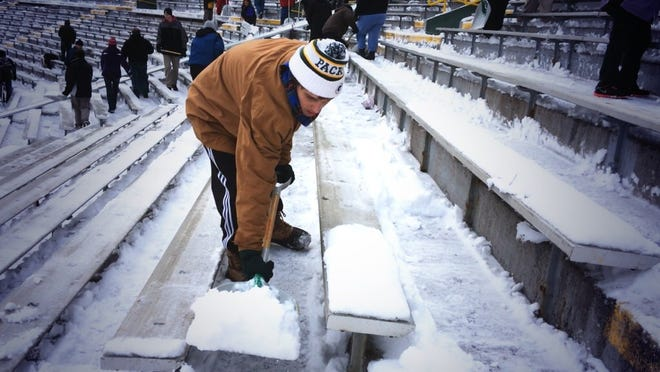 Hundreds of people are needed to shovel out Lambeau Field after a snowfall.