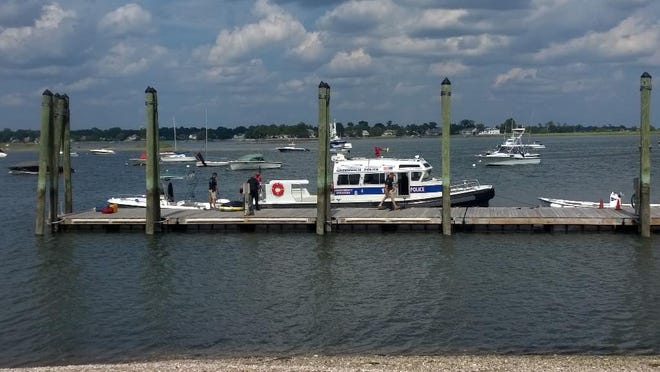 Police and others on the scene of a fatal tubing incident in Long Island Sound off of Greenwich August 6, 2014