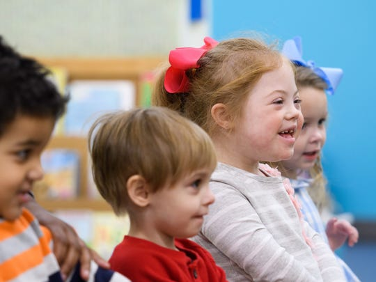 Lily Lape, second from right, participates in a word exercise with classmates, from left, Seth Wilson, Mason Brunt and Ann Brees Raborn, right, at Madison County Preschool in Ridgeland.
