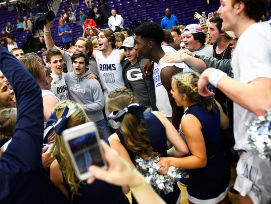 Grace celebrates with fans and cheerleaders after a
