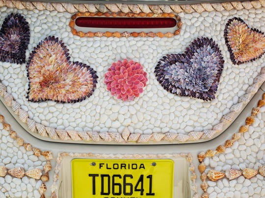 "The Shell Love Bug was unveiled on June 19, 2016 on National Seashell Day on Sanibel Island. The Lee County Visitor and Convention Bureau sponsored the event. Pam Rambo along with volunteers glued the shells to the car. Rambo claims the county promised to give her the car. Her company has sued Lee County in U.S. District Court. She also claims that by continuing to display the vehicle in public, the county has violated her copyright on the design. The News-Press tried to get access to the car to get photos of what it looks like in 2018 but was denied. In an email written by Lee County Spokeswoman Betsy Clayton: ""Per the County Attorney's Office, we are not able to accommodate your request. The car is covered and is not available for public or media inspection at this time since the design of the shells attached to the car is involved in a copyright lawsuit."""