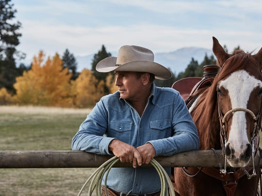 "Kevin Costner as John Dutton on ""Yellowstone."" Darby and Hamilton helped with the show's production."