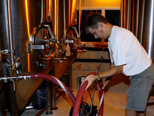 Chris Laumb, 37, St. Cloud, works in O'Hara's brewery Friday. O'Hara's expects its beer production to increase because of the new 64-ounce growler.