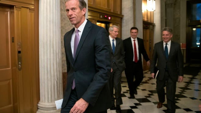 Sen. John Thune, R-S.D., heads to a meeting at the Capitol in Washington. Key senators and farm groups are trying to fix a provision in the federal tax overhaul that gave an unexpected tax break to farmers who sell their crops to cooperatives instead of private buyers.