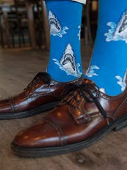 Michael Dickinson of Lewes wears Socksmith shark attack