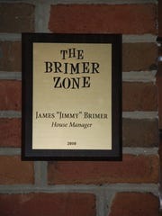A placard in the Clarence Brown Theatre's lobby pays