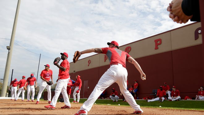 Phillies relief pitcher Phillippe Aumont (right) throws during a workout in Clearwater on Tuesday.