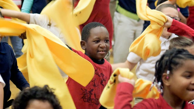 Lincoln Charter School first-grader Xavier Palacios swings his Choice Week scarf while dancing with classmates during an assembly celebrating National School Choice Week at the school Tuesday, Feb. 2, 2016. Bill Kalina photo