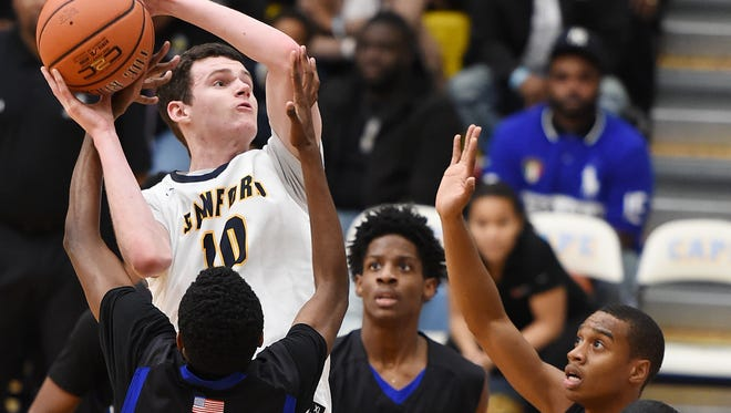 Sanford's Jacob Walsh (10) scores over three Dover defenders at Slam Dunk to the Beach on Dec. 27 at Cape Henlopen High. The Warriors are the No. 1 seed in the upcoming DIAA Boys Basketball Tournament.