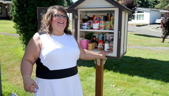 Darla Bradish and her husband, John, created little pantries like this one, from which anyone is welcome to take or donate food. With help from Washington state prison inmates, Bradish now has more of the pantries than places to put them.