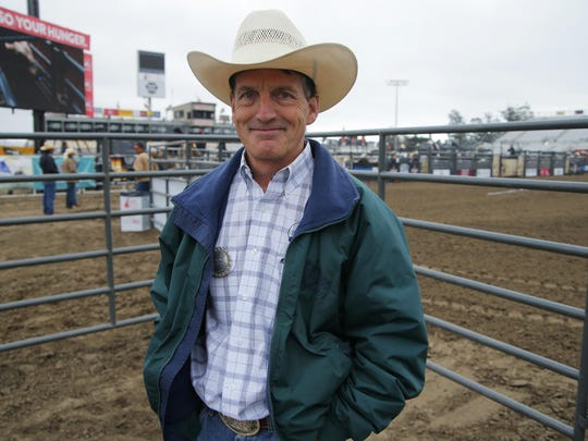 Dr. Bert Tardieu poses for a photo before the start of the 2015 Professional Bull Riding BlueDEF Velocity Tour Event on Wednesday at the Salinas Sports Complex.