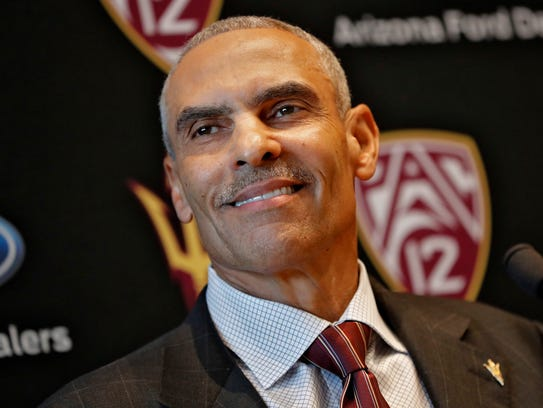 Newly appointed ASU head coach Herman Edwards smiles