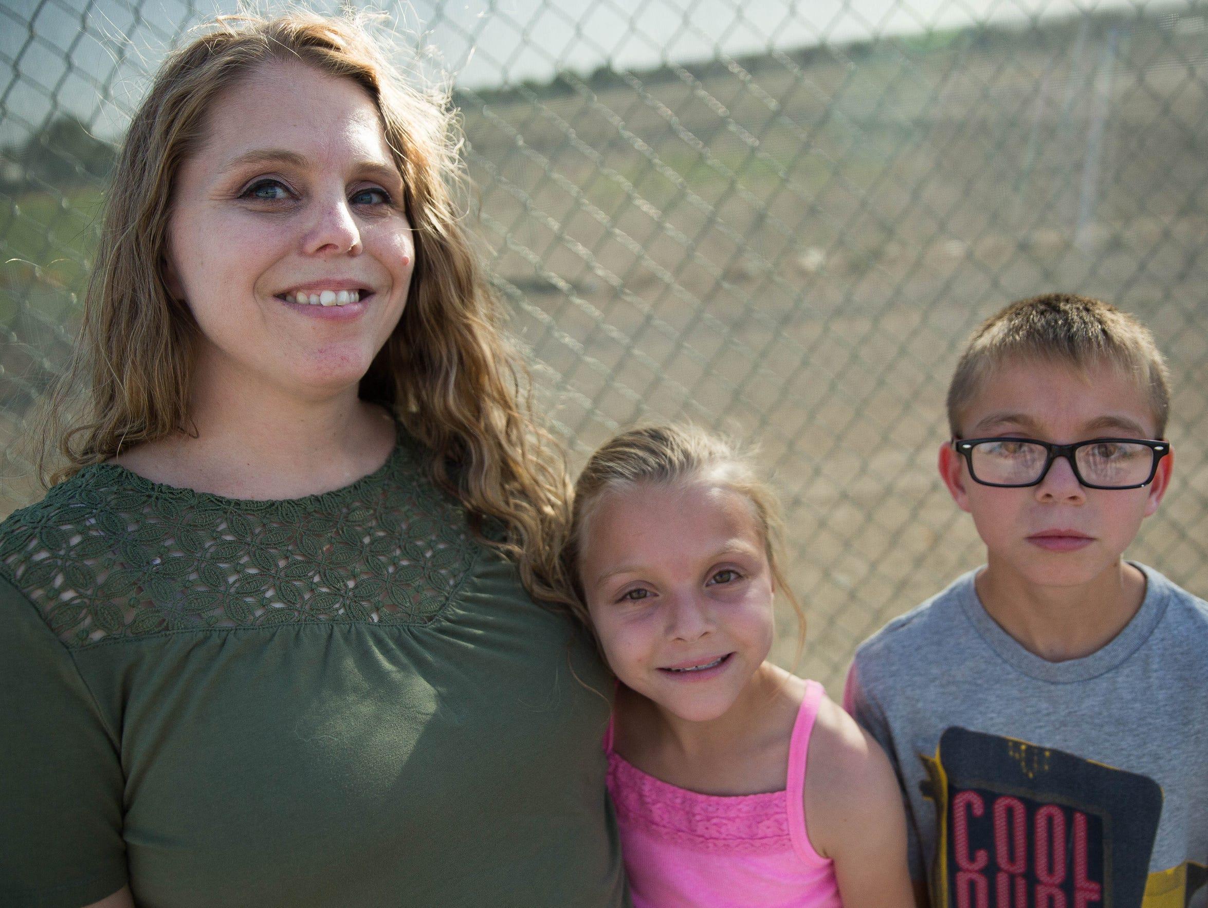 Shawna, Zahmira, 10, and Sabian Silva, at a warm up