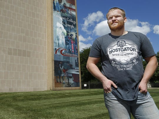 Tyler McCoy stands in front of Calumet College of St. Joseph in Whiting. A McCutcheon High School graduate, McCoy went from college wrestler to addict to prison inmate.