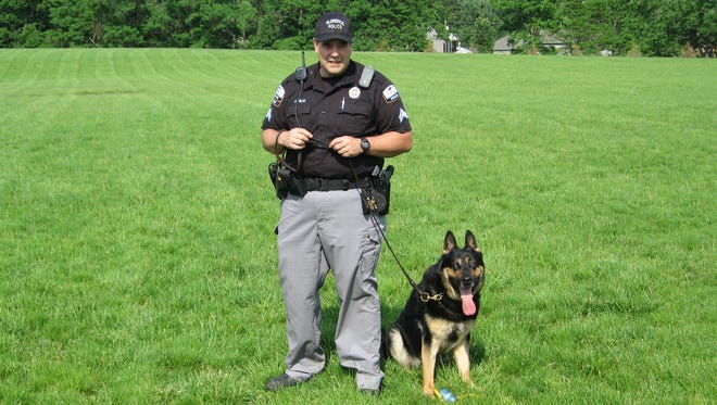 Max, retired Florence Police K9 dog, with his lifelong partner, retired Officer John Dolan.