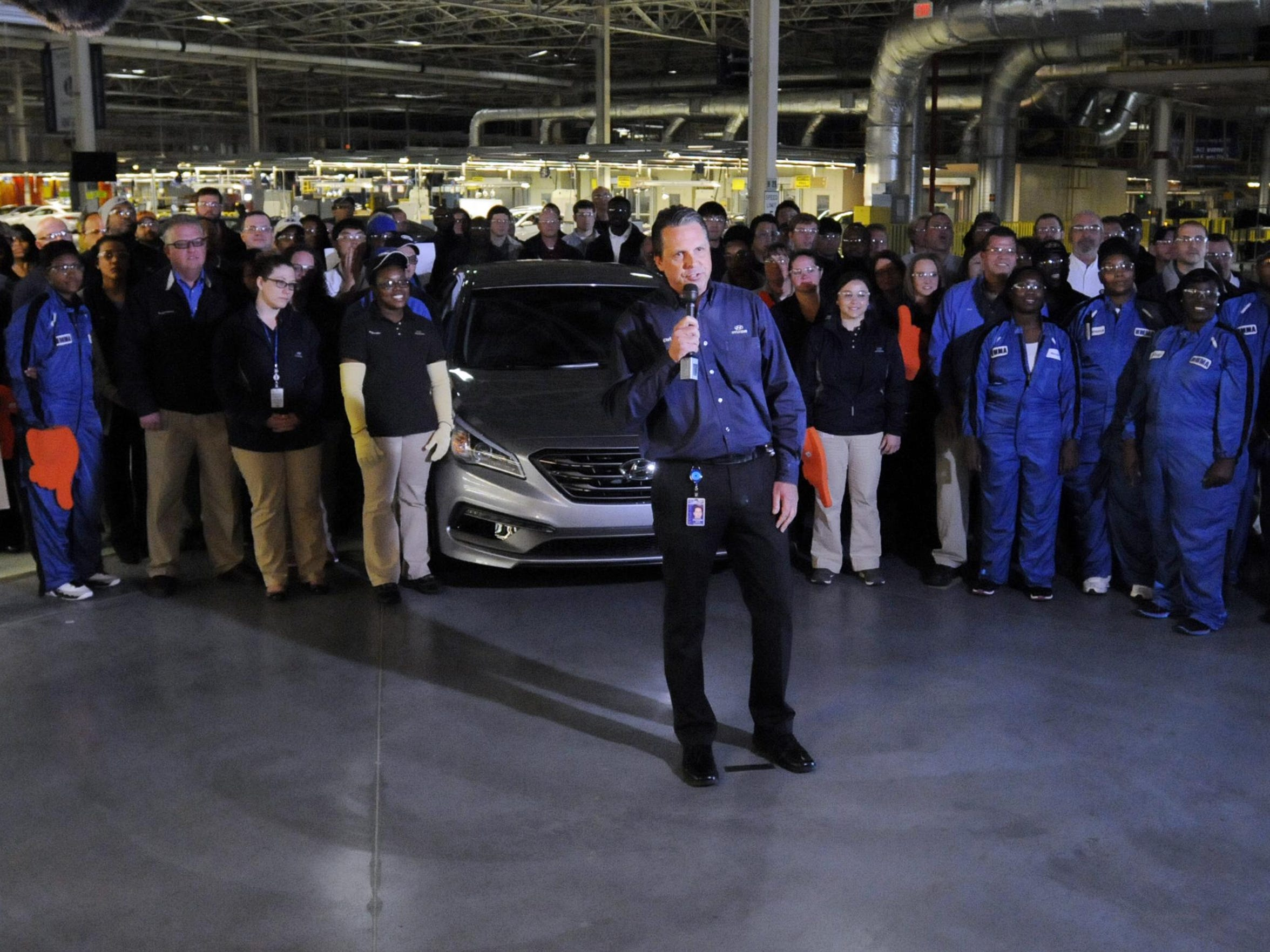 Chris Susock, vice president of production  in Montgomery, center, and plant workers unveiled the redesigned, Montgomery-made Sonata last spring during a live remote from the plant broadcast at the Detroit Auto Show, a car that launched to critical praise and wide demand.