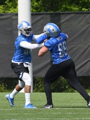 Tight ends Eric Ebron (left) and Cole Wick go head-to-head