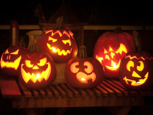 Pumpkins cut into Jack O' Lanterns with candles inside
