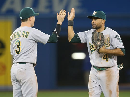 Coco Crisp (right) was recently hired to coach baseball