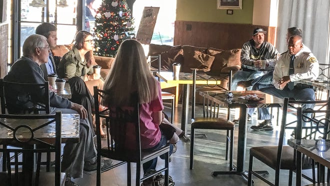 Members of the community attend a Coffee with a Cop event at Java Werks to ask Hattiesburg police officers, including Michael Fleming and Carlos Cook, pictured here, about their public safety concerns. The event is held at 8 a.m. the second Tuesday of the month at Java Werks on Hardy Street.