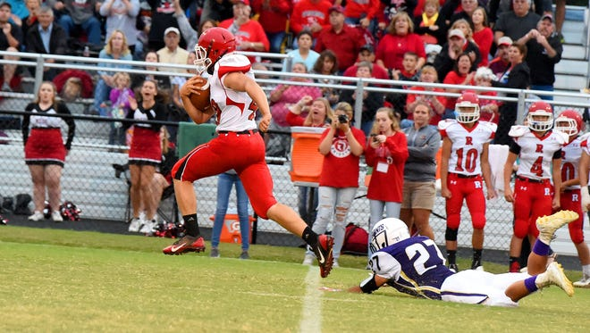Riverheads' Harrison Schaefer breaks away from Waynesboro's Phillip Monterrozo for one of his three touchdowns Friday against the Little Giants. Schaefer now has 10 TDs in three games.