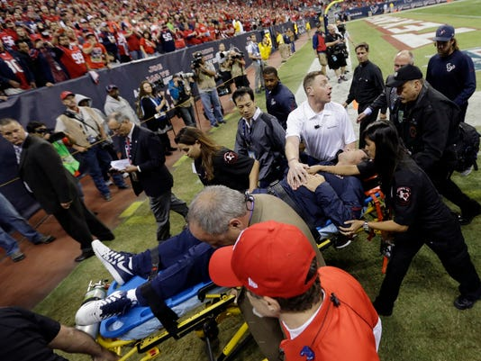 FILE - In this Nov. 3, 2013, file photo, Houston Texans head coach Gary Kubiak is carted off the field on a stretcher during the second quarter of an NFL football game against the Indianapolis Colts in Houston. These days, word of a coach making an emergency trip to the hospital has grown so common it could almost be part of the injury report.  (AP Photo/David J. Phillip, File)