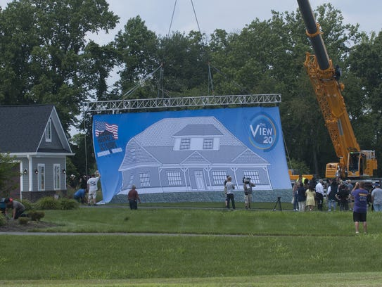 A giant tarp covers the new Mullica Hill home of Veteran
