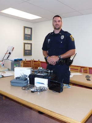 Herkimer Police Officer James Burns displays the department's new drones and equipment, which will also be available to assist village departments and other county agencies.