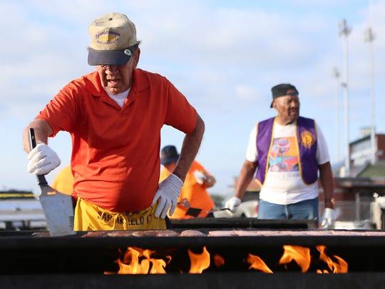 Volunteers flip sausage patties for the pancake breakfast