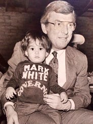 Mark White holding a young Joe Moody, now a state representative,