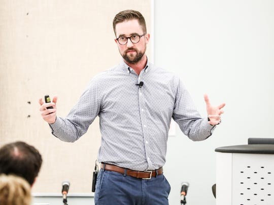 Austin Eubanks, a survivor of the Columbine school shooting in Colorado, speaks about addiction resulting from trauma during the 11th Annual Susan Li Conference at Hope Academy Recovery High School in Indianapolis on Thursday, July 19, 2018.