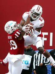 Badgers wide receiver Quintez Cephus hauls in a touchdown pass over Indiana defensive back Tony Fields during their game this season.