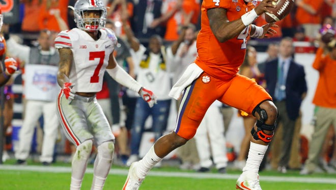 Clemson quarterback Deshaun Watson (4) runs the ball for a touchdown against Ohio State during the third quarter of the College Football Playoff Semifinal game in the PlayStation Fiesta Bowl on Dec. 31, 2016 at University of Phoenix Stadium in Glendale, Arizona.