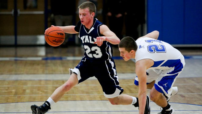 Yale junior Josh McClelland drives the ball past Cros-Lex senior Trevor Sheridan during a basketball game Feb. 18, 2014, at Cros-Lex High School.