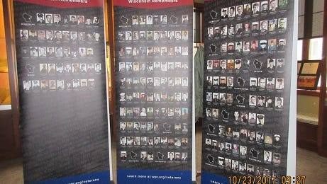 An exhibit at the Town Hall Library in North Lake shows the photos of the 1,161 Wisconsinites listed on the Vietnam Veterans Memorial Wall in Washington, D.C. The traveling exhibit is on display at the library through October.