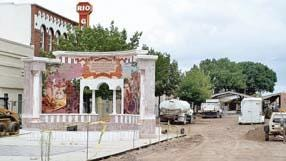 The La Entrada monument is removed from the Downtown Mall in August 2006.