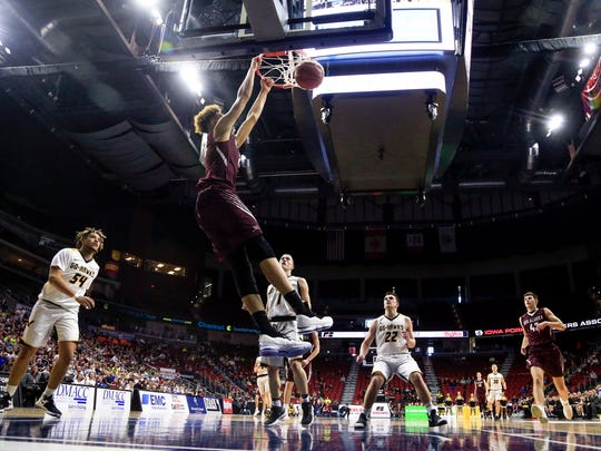 Xavier Foster of Oskaloosa dunks the ball during the 3A semifinal game against Waverly Shell Rock at Wells Fargo Arena Thursday, March 8, 2018.