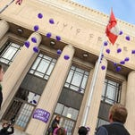 Activists release balloons on the steps of the Civic Center in this file photo.