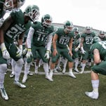 Michigan State investigating football program; 4th warrant requested