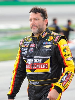 NASCAR Sprint Cup Series driver Tony Stewart (14) after his qualifying run for the Quaker State 400 at Kentucky Speedway in June.