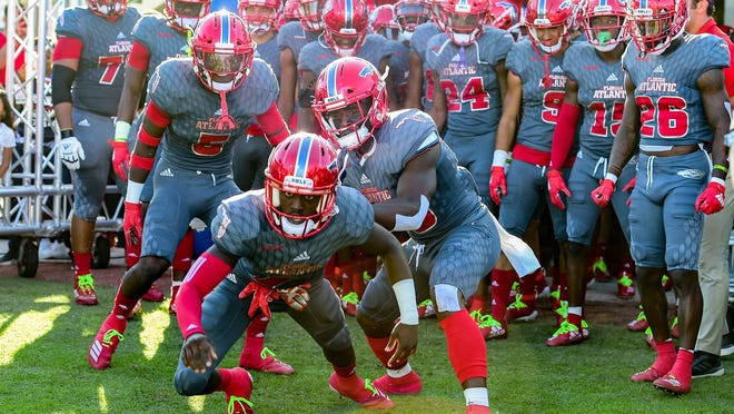 Florida Atlantic players prepare to run out of the tunnel before a 34-17 victory over Southern Miss on Nov. 30, 2019. FAU clinched Conference USA's East Division with the win.