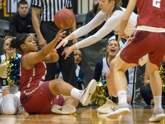 Saint Joseph's Chelsea Woods (32) regains possession of the ball against George Washington during the first half of an NCAA college basketball game in the Atlantic-10 championship tournament in Richmond, Va., Sunday, March 4, 2018. (AP Photo/Matt Bell)