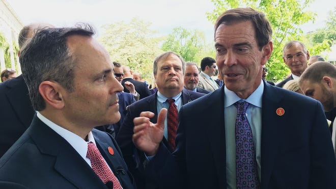 Braidy Industries Inc. CEO Craig Bouchard, right, and Republican Gov. Matt Bevin speak with reporters in Wurtland, Ky, Wednesday, April 26, 2017. The aluminum company says it will spend $1.3 billion to build an aluminum plant in Eastern Kentucky, pledging to hire 550 people.