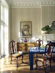"Thomas Jayne explains in ""American Decoration"" how this dining room's rich collection encompasses everything from the wallpaper with an ""eighteenth-century English pattern of alternating stripes"" to a 1970s dining table lacquered in blue."