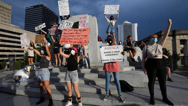 Protesters stand outside the State Capitol in Nashville, Tenn., Wednesday, Aug. 12, 2020.