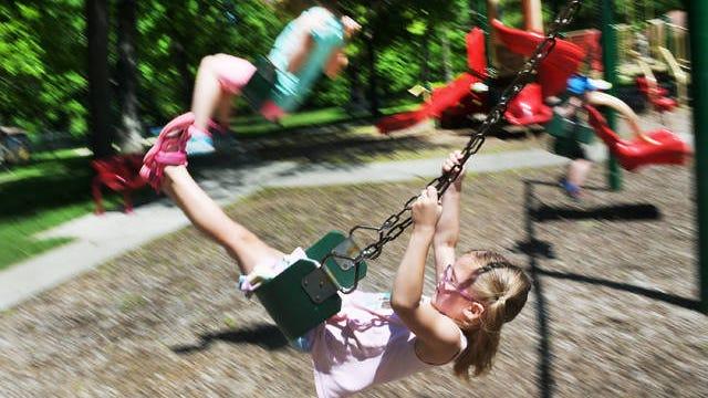 Fennley Slinken, 5, enjoys swinging at Brookside Park after playgrounds were officially reopened on Monday, June 1, following a proclamation last week from Gov. Kim Reynolds. Photo by Nirmalendu Majumdar/Ames Tribune