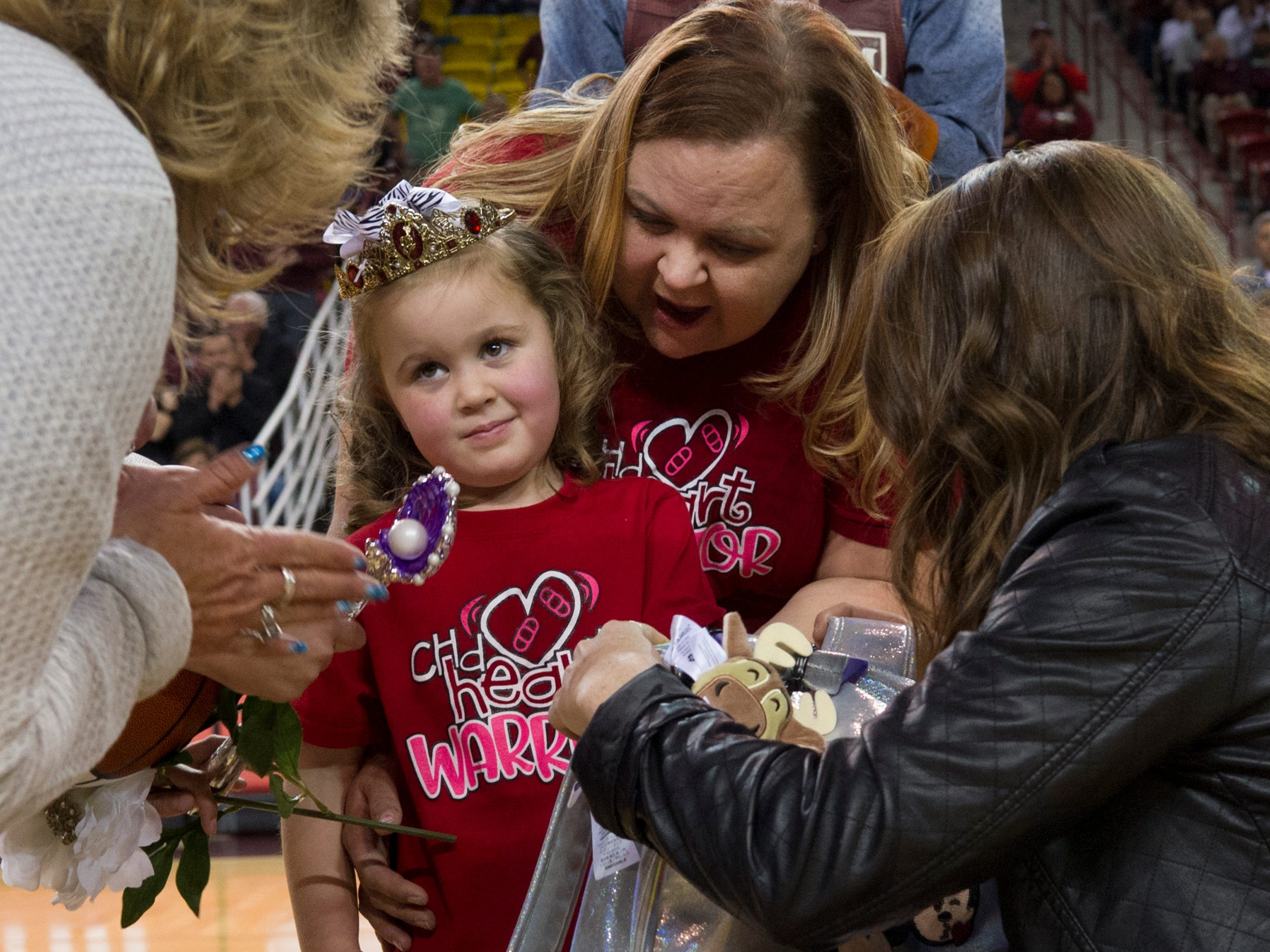 Dana Jorgensen, left, of Make a Wish-A-Wish New Mexico, talks with 5-year-old Kayla Maki of Las Cruces, and her mother, Ashley Maki. Kayla Maki, who has a serious heart condition, is set to go to Disney World with her family, thanks to her wish being granted. Also seen is Kelsey Wright, right, a wish granter with the Make-a-Wish New Mexico organization.