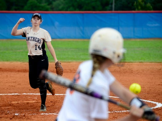 Milton High School pitcher Megan Robertson lets the ball go while Escambia High School hitter Sarah Crutchfield sizes up the ball Thursday in a 1-6A semifinal at Pine Forest High.