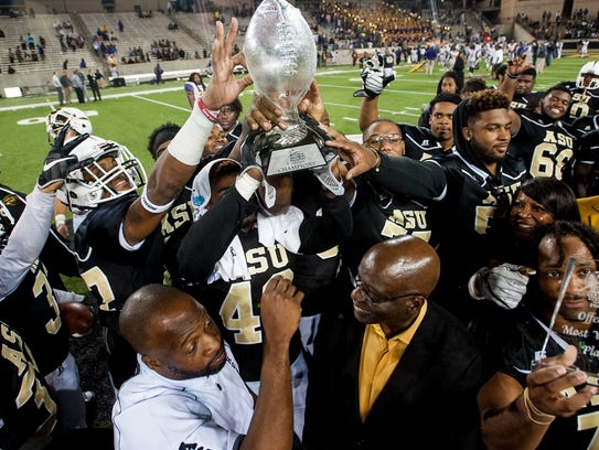 Alabama State players lift the Turkey Day Classic trophy